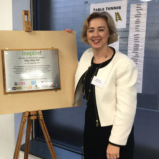 Chair Emma West with building plaque
