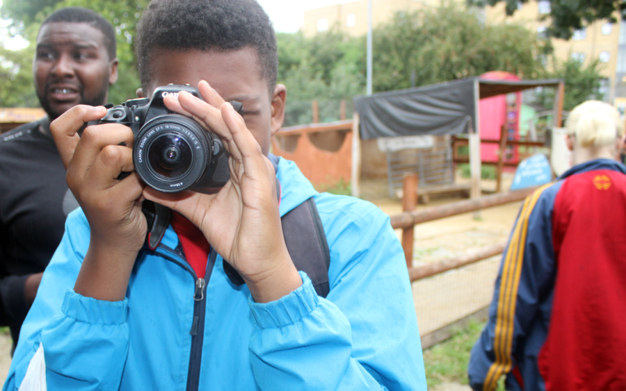Student from the Inspired Directions School taking photograph