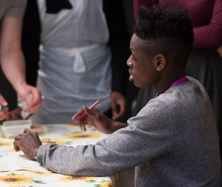 A student takes part in a community action project in Hackney