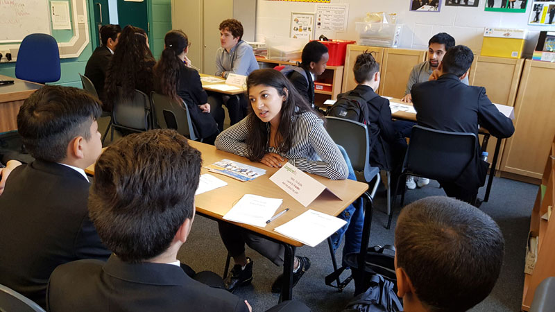 Employee volunteers take part in a Careers Carousel at Duke's Academy