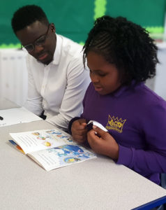 A volunteer from Sanctuary Housing reads with a pupil at Kingsmead Primary School