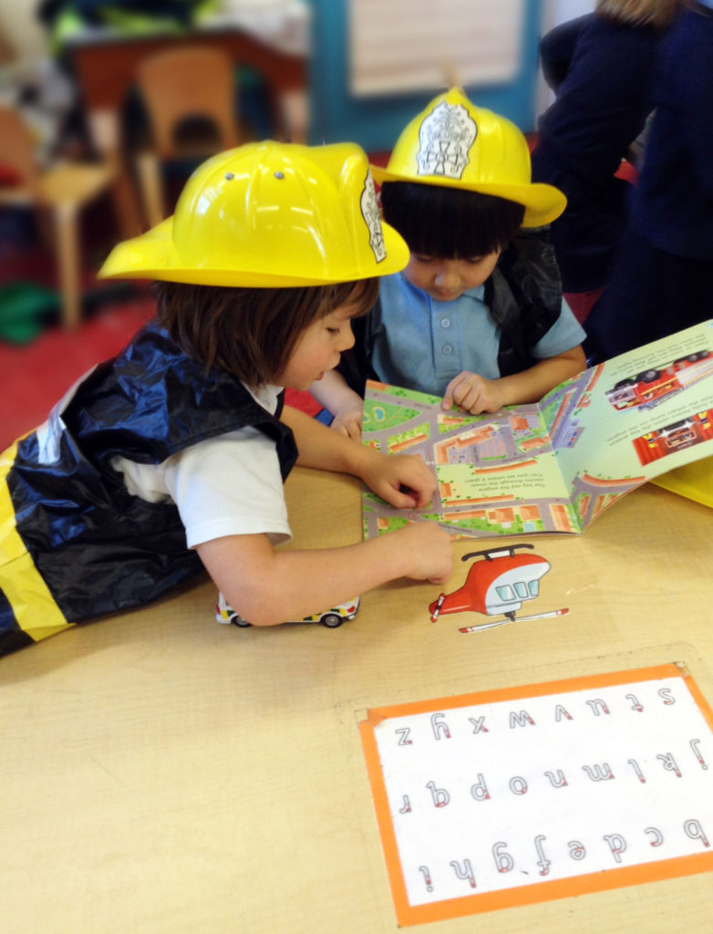 Reception pupils learn about jobs in the emergency services during Work Week, a primary work-related learning programme.