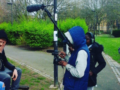 An Inspired Directions student films a documentary with Mouth that Roars