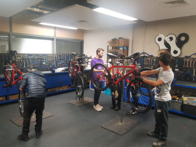Bike project students with teacher